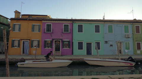 Burano island view with street along the canal, Italy Archivo