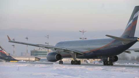 Aeroflot aircraft A330 taxiing in Moscow airport, winter view Archivo