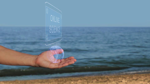 Hands on beach hold hologram text Online science Footage