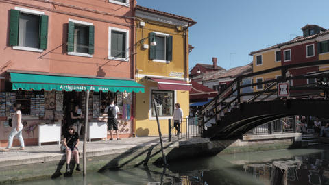 Burano scene with souvenirs store and bridge over the canal, Italy Archivo