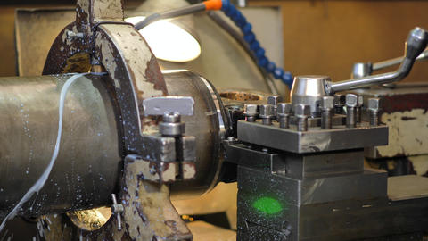 Turning lathe in action.Facing operation of a brass blank on turning machine Live Action