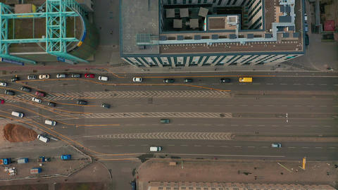 Aerial view. multilane road with arrow symbol. Urban cars speeding on road Footage