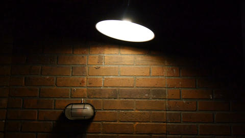 Loft style ceiling light turned on swinging side to side. Filmed with studio Live Action