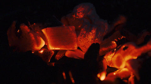 Glowing charcoal in the grill at night. Close-up shot on Red camera Live Action