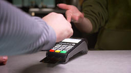 Close-up shot of person inserts credit card into terminal and enters the pin Footage