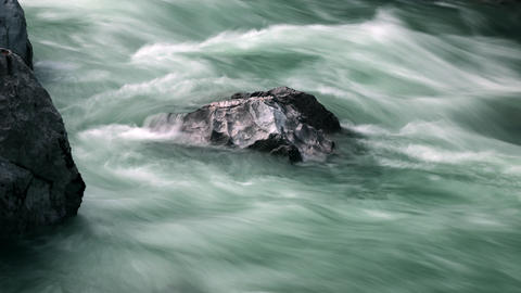 Timelapse - Whitewater flowing around the rock Footage