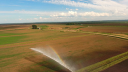 Aerial view:Irrigation system watering a farm field Footage