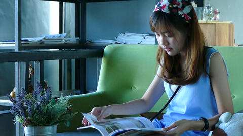 Woman read magazine in coffee cafe Live Action