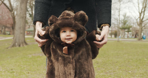 Adorable baby girl at the park dressed as a bear Footage