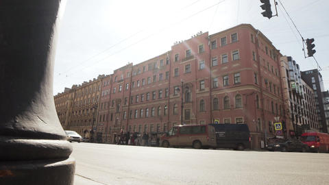 View of pink old beautiful building located near big wide busy road in big city Footage