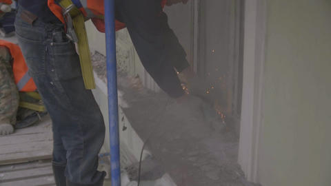 Construction worker works with power cutting machine to cut part of wall Footage