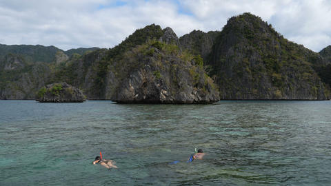 Couple snorkling in front of islands at Coron, Philippines Live Action