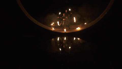 Extreme family of circus artists make fire show with poi in slow motion Footage