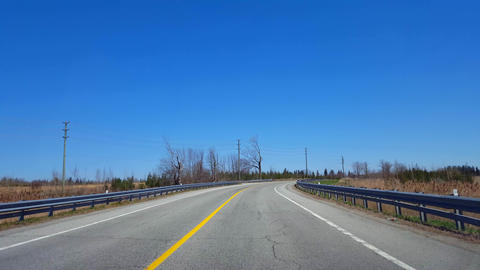 Driving Rural Countryside During Spring Day. Driver Point of View POV Along Beautiful Sunny Country Live Action