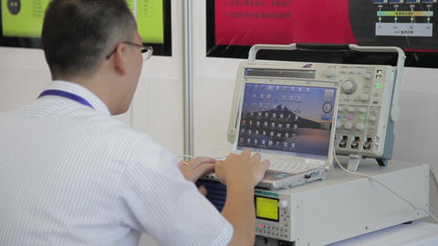 XI'AN - AUG 29:View of engineer using a notebook PC with instrument, Aug 29 Footage