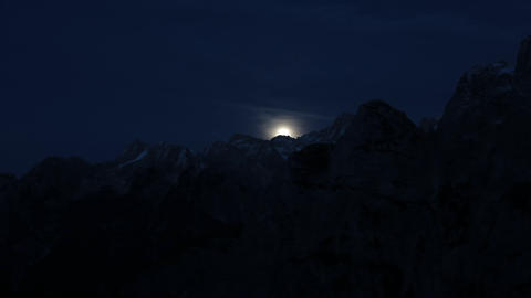 Timelapse - Moon over the rocky mountains at night Live Action