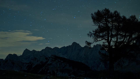 Timelapse - Mountain range behind a tree at night with shooting stars Footage