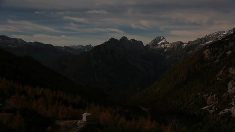 Timelapse - Majestic mountain range with clouds rolling over it Live Action