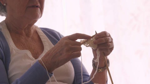 Senior woman knitting a wool Footage