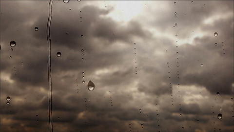 Storm clouds flying fast through the rainy window, close up view Footage