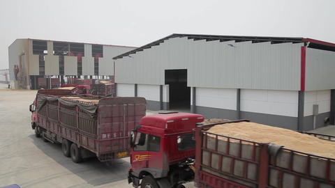 XI'AN - JUL 06: Truck transport wheat in grain reserve depot, Jul 06, 2013 Footage