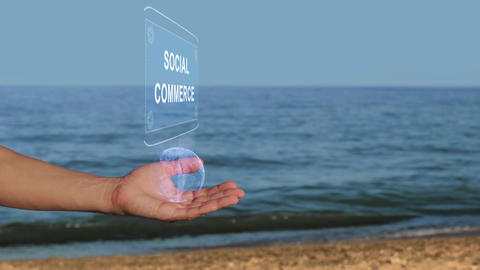 Hands on beach hold hologram text Social commerce Live Action