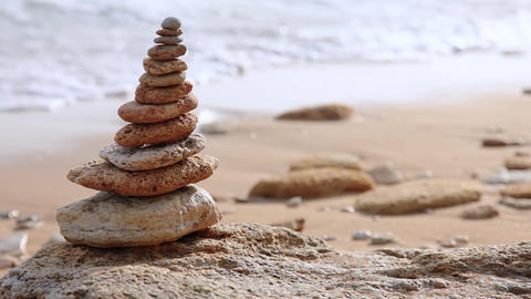 [alt video] Pebble Pyramid and Defocused Morning Surf. Seamless Loop