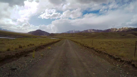 Driving a bus on a country road,Qinghai,China Footage