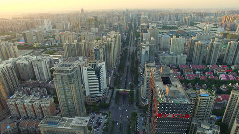 AERIAL shot of traffic moving on road and cityscape at sunset,Xi'an,China Footage