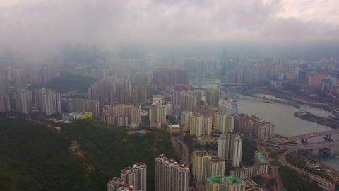 Aerial view of Victoria Harbour, Hong Kong Downtown with rain storm, Republic of China. Financial Live Action