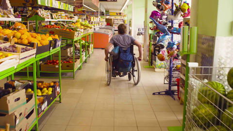 A man in a wheelchair in the supermarket Footage