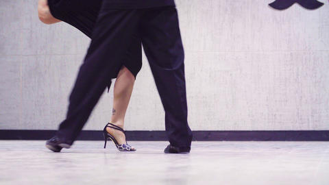 Legs of couple dancing tango Footage