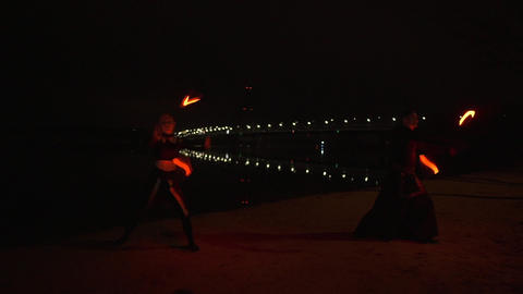 Two circus artists make led show on the bank of the river Dnipro in Kyiv Footage