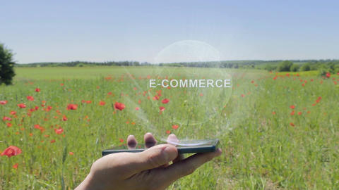 Hologram of E-commerce on a smartphone Live Action