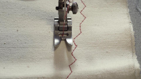 Slow motion working sewing machine Live Action
