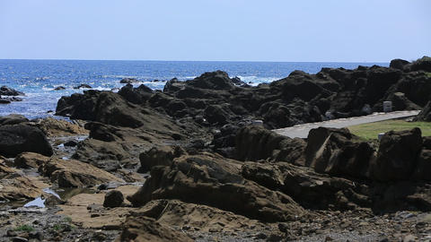 A sunny day with a rocky shore Stock Video Footage