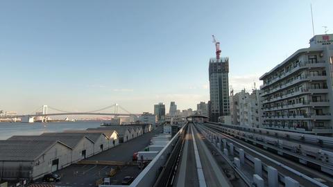 Japan city scenery. Urban traffic traveling near Tokyo Bay ビデオ