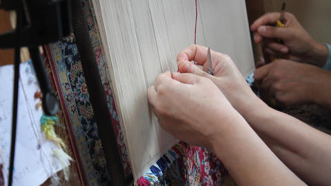 Silk carpet with hand woven. Two women are weaving silk carpet by hand Live Action