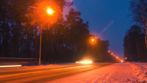 Winter highway road at night. View on night highway, speed concept Live Action