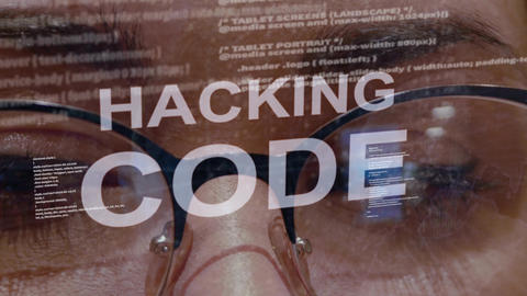 Hacking code text on background of female developer Footage
