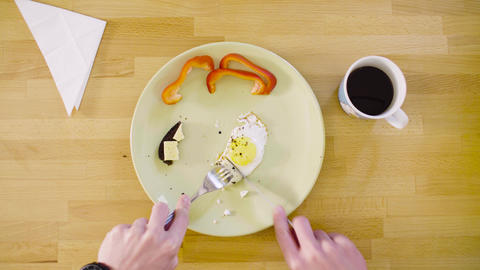Man eating an omelet and a sandwich Stock Video Footage