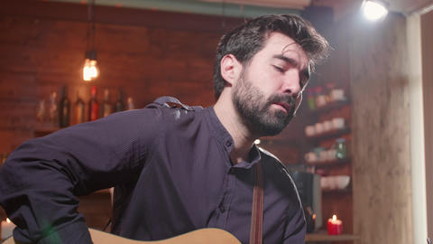 Closeup portrait of a male musician singing a song Footage