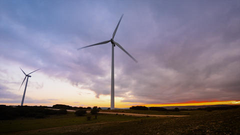 Time lapse motion of Wind Turbine in wind farm on sunset Live Action