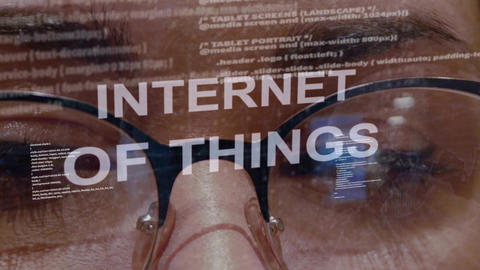 Internet of things text on background of female developer Footage