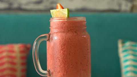 Fresh tropical organic strawberry smoothie rotate on table Footage