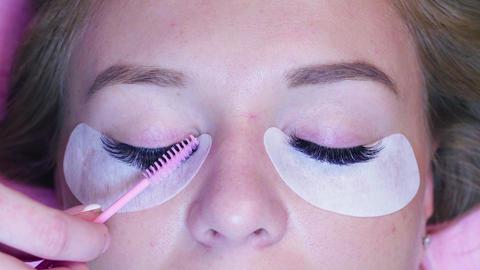 Cosmetologist combing eyelashes Live Action