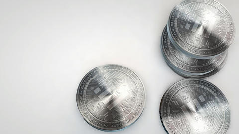 silver iconomi coins falling on white background Animation