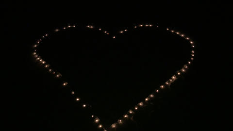 Aerial - Candle lights in the shape of heart Footage