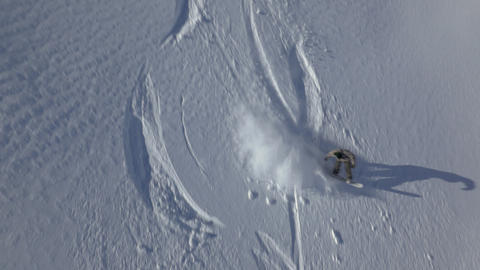 Aerial - Snowboarder going down the slope Footage