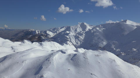 Aerial - Snow capped mountains and ridges Footage